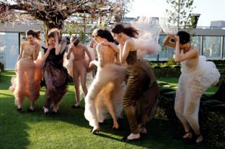 A gust of wind catches a group of models in China