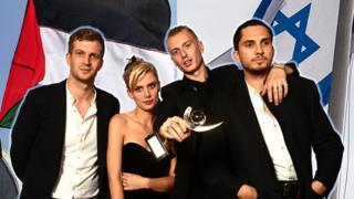 Wolf Alice photoshopped with Israel and Palestine flags