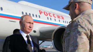 Russian President Vladimir Putin arrives to the Russian air base in Hmeimim in Syria, 11 December 2017