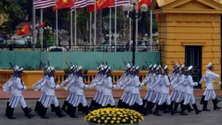 Vietnamese Navy honour guard marches to take position prior to the arrival of US President Barack Obama for a welcoming ceremony at the Presidential Palace in Hanoi