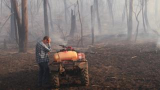 A rancher struggles with a conditions on his skill nearby Labertouche, Victoria