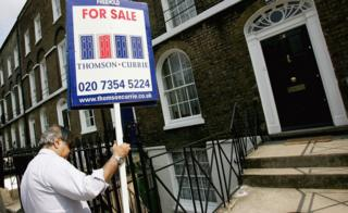 estate agent erects for sale sign