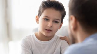 Boy talking to his dad