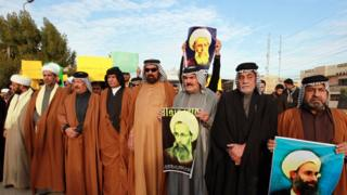 Iraqis hold placards bearing portraits of prominent Shia Muslim cleric Nimr al-Nimr during a protest held in the capital Baghdad, on January 3, 2016, against his execution by Saudi authorities. The Saudi cleric was a driving force of the protests that broke out in 2011 in Saudi Arabia's east, an oil-rich region where the Shia minority of an estimated two million people complains of marginalisation.