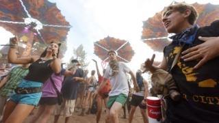 Festival goers dance at the Oregon Eclipse Festival, August 20, 2017, at Big Summit Prairie ranch in Oregon's Ochoco National Forest near the city of Mitchell ahead of the total solar eclipse on August 21, 2017.