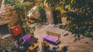 Tourists in Fauzi Azar Inn's courtyards