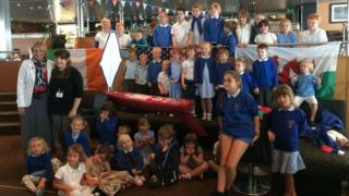 Pupils hand boat back to US teacher
