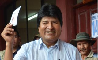 Bolivian President Evo Morales holds up his ballot before depositing it on 21 February 2016