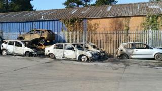 A photo showing burnt cars