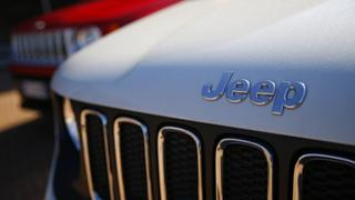 In this file photo taken on August 21, 2017 a car dealer in Turin shows the logos of Jeep, brands of Fiat Chrysler Automobiles (FCA).