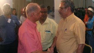 Seychellois President James Michel (L) congratulates Seychellois Democratic Alliance (known by its creole acronym LDS) leader Roger Mancienne in victoria on September 11, 2016.