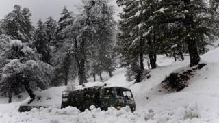 An Indian Army truck travels towards the avalanche site, in Tangmarg on February 8, 2010.