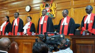 Judges stand to deliver their verdict at the Supreme Court in Nairobi on September 1, 2017, ordering a new presidential election within 60 days after cancelling after cancelling the results of last month's poll.