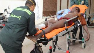 An African migrant, who was wounded during gunfire near the border with Israel, lies on a stretcher as he is taken to the hospital at Al Arish city, in the northern part of Sinai peninsula.