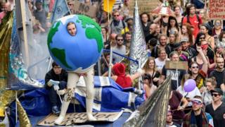 One demonstrator dresses as a globe in Hamburg