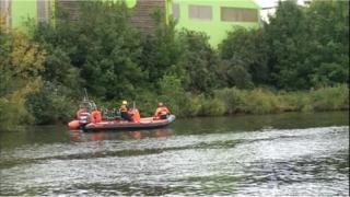 Fire service teams searching the River Taff after reports of a body in the water