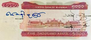 Image of a 5,000 kyat banknote, signed by Aung San Suu Kyi, former dictator Than Shwe and current president Thein Sein