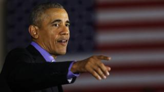 Former US President Barack Obama speaks during a campaign rally in Newark, New Jersey on 19 October