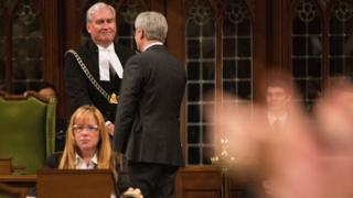 Former Canadian prime minister Stephen Harper shakes hands with Kevin Vickers in the House of Commons