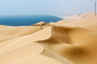 Sand dunes on the desert coast of Namibia