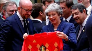 "Theresa May receives Belgium""s national soccer team jersey from Belgian Prime Minister Charles Michel"