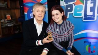 Sir Paul McCartney with Blue Peter presenter Lindsey Russell and his gold badge