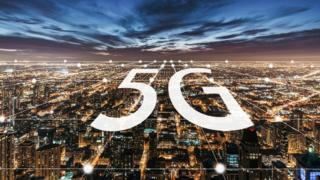 A stock image of a 5G logo over a big city
