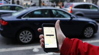 Uber app in hand