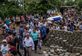 Hundreds of people accompany the coffin of Cristhian Gutierrez Ortega, 60, hit by a police sniper bullet during a demonstration against President Ortega