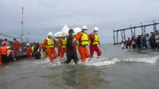 Myanmar rescuers recover a body from the plane crash in the Andaman Sea, on 8 June 2017
