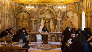 Monks eat in silence in the refectory of Pantokratoros monastery on December 3, 2016 in Mount Athos,Greece. Some of the buildings on the mountain date back to the 10th century, many of which are still in use to this day