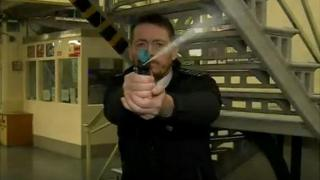 Prison officer deploys pepper spray