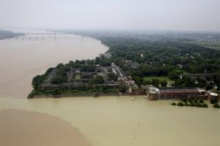The Flooded river Ganges is seen from a helicopter in Allahabad, India, Friday, Aug. 26, 2016.