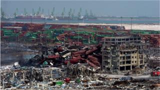 Mangled cargo containers and twisted wreckage at the site of the explosions in Tianjin