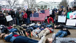 FEBRUARY 19: Demonstrators lie on the ground a 'lie-in' demonstration supporting gun control reform near the White House on February 19, 2018 in Washington, DC. According to a statement from the White House, 'the President is supportive of efforts to improve the Federal background check system.', in the wake of last weeks shooting at a high school in Parkland, Florida