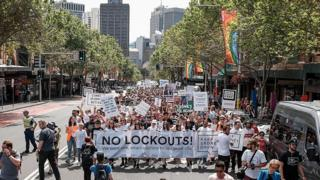 Protesters march down Sydney's Oxford St calling for the lockout laws to be repealed in 2016