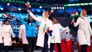 Iran delegates during the opening ceremony for 2018 winter games, waving flags in venue