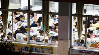 Senior high school students studying at night to prepare for the college entrance exams