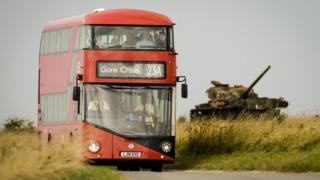 A Routemaster bus on its way to the deserted village of Imber on Salisbury Plain, Wiltshire