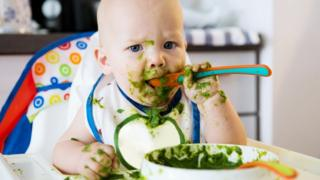 Toddler eating solids