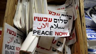 Stickers bearing the logo of Peace Now, an Israeli NGO, at its offices in Tel Aviv (31 January 2016)
