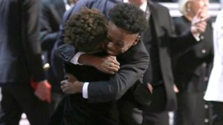 Jaden Piner and Alex R Hibbert embrace as 'Moonlight' wins the best picture award at the Oscars on Sunday, Feb. 26, 2017, at the Dolby Theatre in Los Angeles.