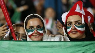 Female Iranian football fans attend a screening of a 2018 World Cup match at the Azadi Stadium in Tehran