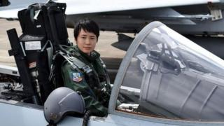 First Lieutenant Misa Matsushima of the Japan Air Self Defence Force poses in the cockpit of an F-15J air superiority fighter