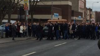 Mourners carry the coffin of Eddie Hutch at his funeral in Dublin