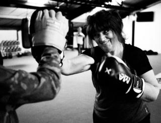 A woman practices her boxing.