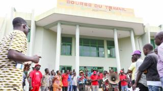 Demonstrators gather on June 22, 2017 in front of di labour exchange inside Cotonou during on protest against bad governance.