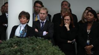Staff members listen as U.S. President Barack Obama, not pictured, speaks in the Rose Garden at the White House in Washington, D.C., U.S., on Wednesday, Nov. 9, 2016