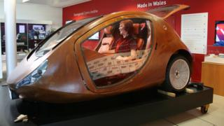 A prototype for a three-wheeled wooden car