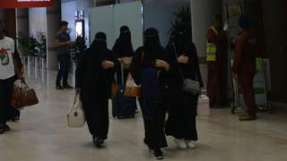 A picture taken during a guided tour with the Saudi military on 13 June 2019 shows Saudi women arriving at Abha airport in the popular mountain resort of the same name in the southwest of Saudi Arabia